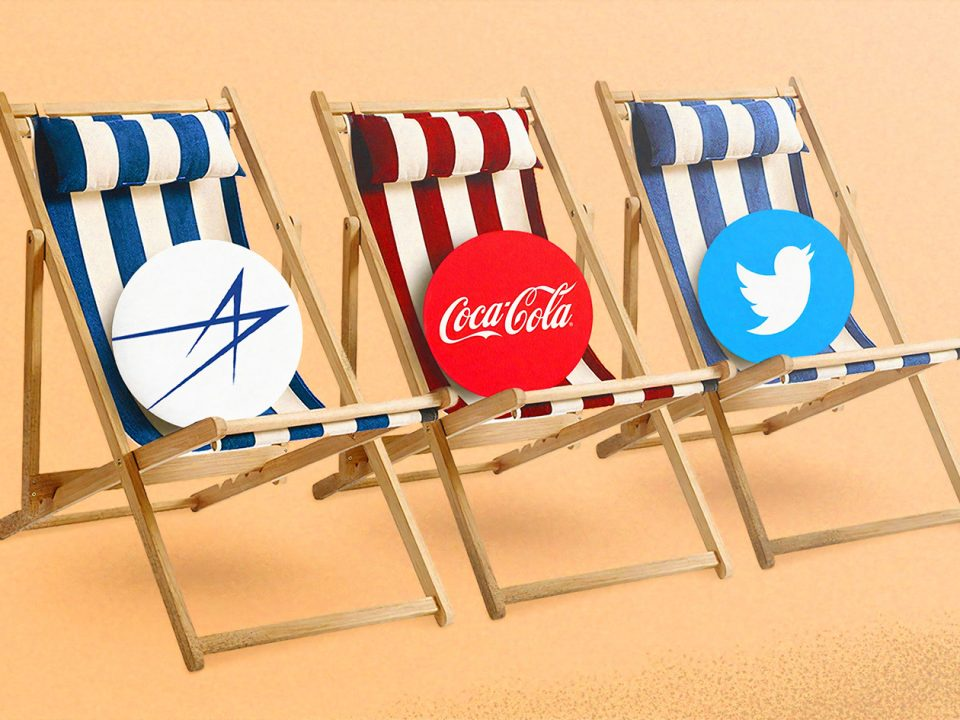 three major brand logos sitting on striped beach chairs