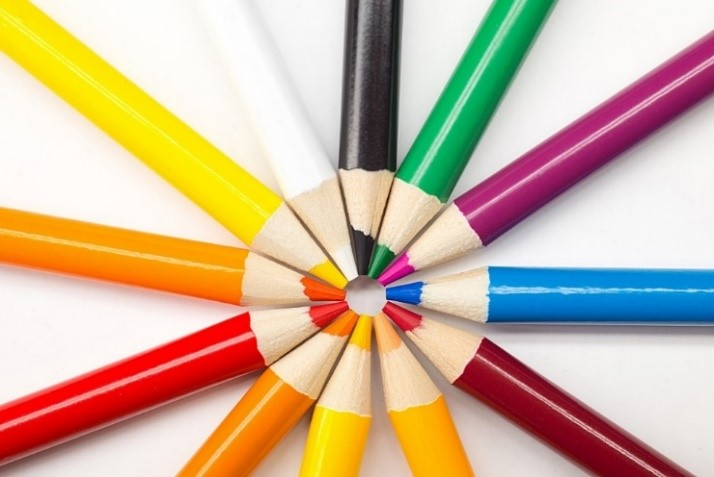 coloured pencils pointing inwards in a circle
